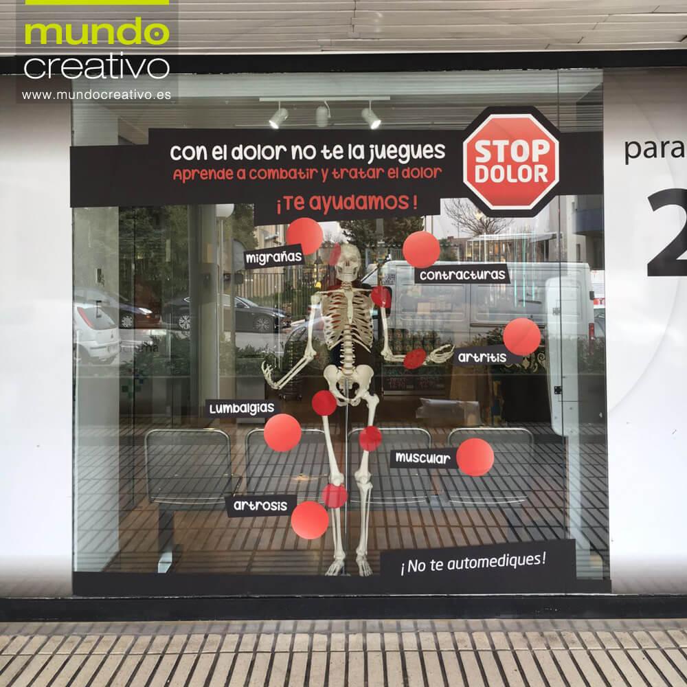 Escparate campaña Dolor en Farmacia El burgo, Madrid. Mundo Creativo